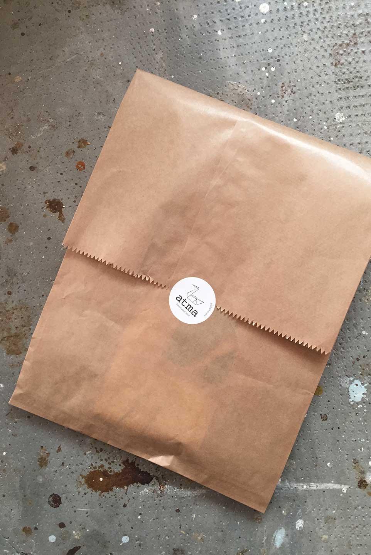 utilizziamo buste di carta per ridurre il nostro impatto ambientale