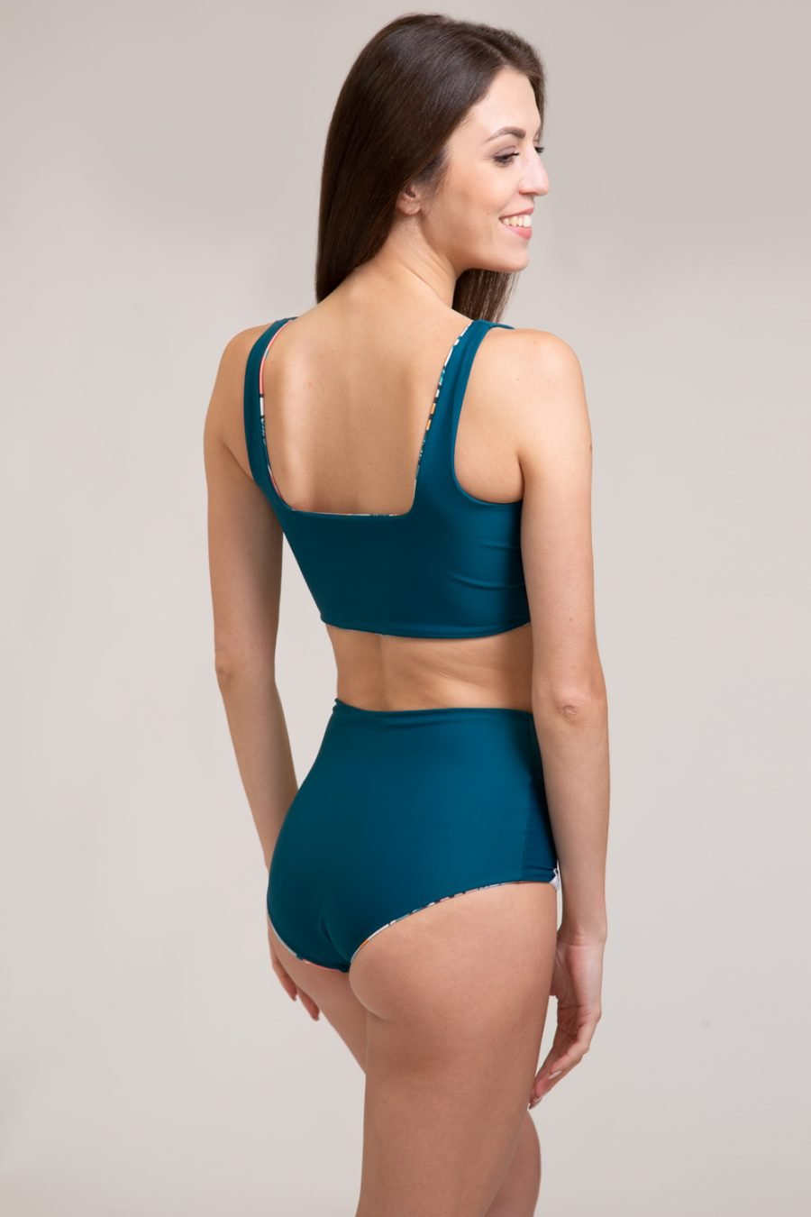 double face bikini yoga clothing for women made in Italy green color and tropical pattern econyl yarn and recycled fabric
